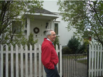 Erling Storrusten in front of his boyhood home.  If the narrow window at the on the right side of the door  was open, he was not to enter.